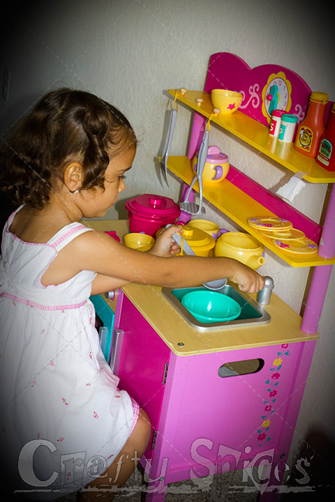 Kira playing with her new Kitchen