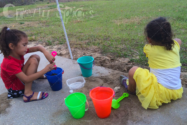 The Girls playing with Sand in our backyard