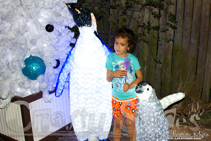 Kira with the lighted penguins at Busch Gardens Christmas town