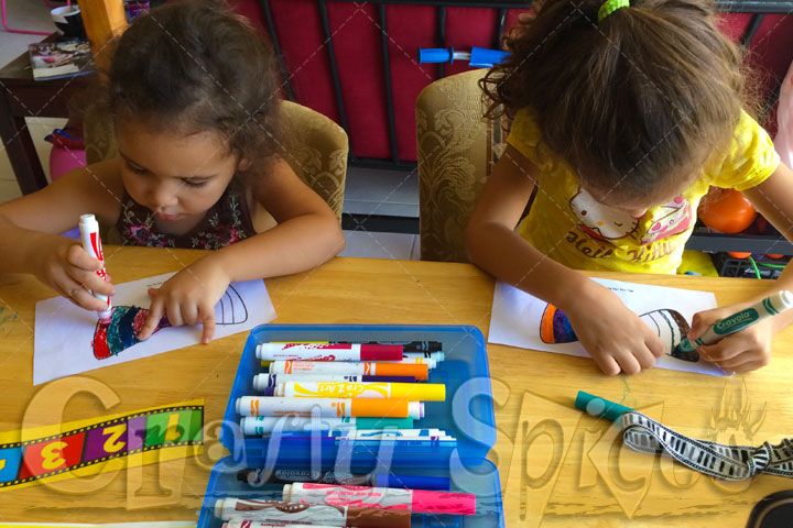 The Girls coloring with Markers