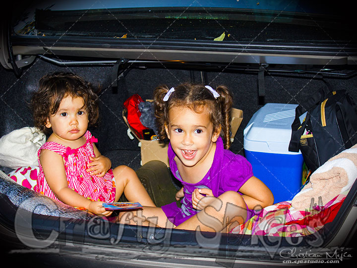 Kira and Kaylee having fun in the trunk of our car