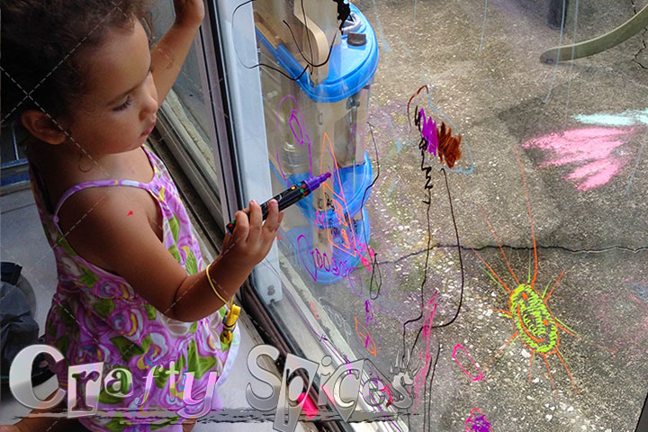 Our little girl using the Liquid Chalk Ink Markers by ChalkOla