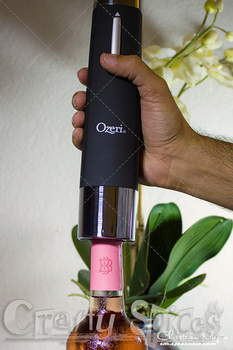 Ozeri OW05A Prestige Electric Wine Bottle Opener opening a bottle